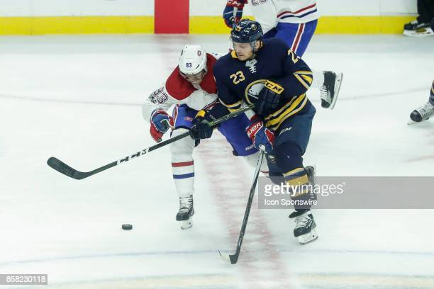 Buffalo Sabres Center Sam Reinhart and Montreal Canadiens Right Wing Ales Hemsky fight for puck during the Montreal Canadiens and Buffalo Sabres NHL...