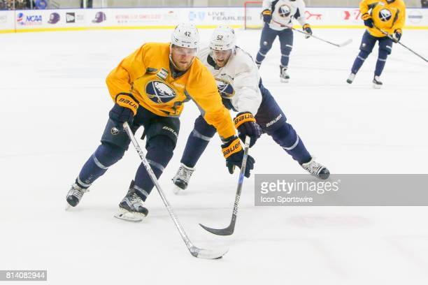 Buffalo Sabres Center Sean Malone controls the puck as Buffalo Sabres Right Wing Hudson Fasching defends during the French Connection Tournament at...