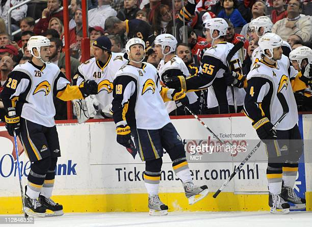 Buffalo Sabres center Tim Connolly watches a replay of his goal as teammates on the bench congratulate him during the second period against the...