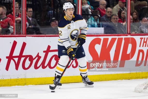 Buffalo Sabres Defenceman Brandon Montour plays the puck behind the net during first period National Hockey League action between the Buffalo Sabres...