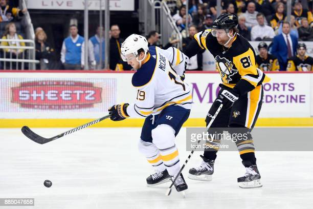 Buffalo Sabres Defenseman Jake McCabe moves the puck as Pittsburgh Penguins Right Wing Phil Kessel forechecks during the second period in the NHL...