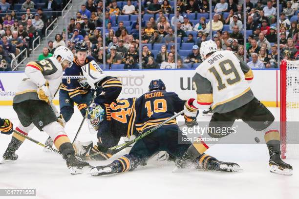 Buffalo Sabres defenseman Jake McCabe Vegas Golden Knights right wing Reilly Smith and Vegas Golden Knights left wing Max Pacioretty track loose puck...