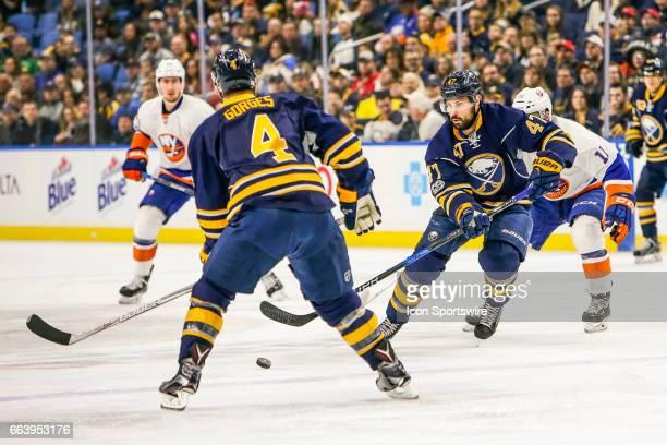 Buffalo Sabres Defenseman Zach Bogosian passes to Buffalo Sabres Defenseman Josh Gorges during the New York Islanders and Buffalo Sabres NHL game on...