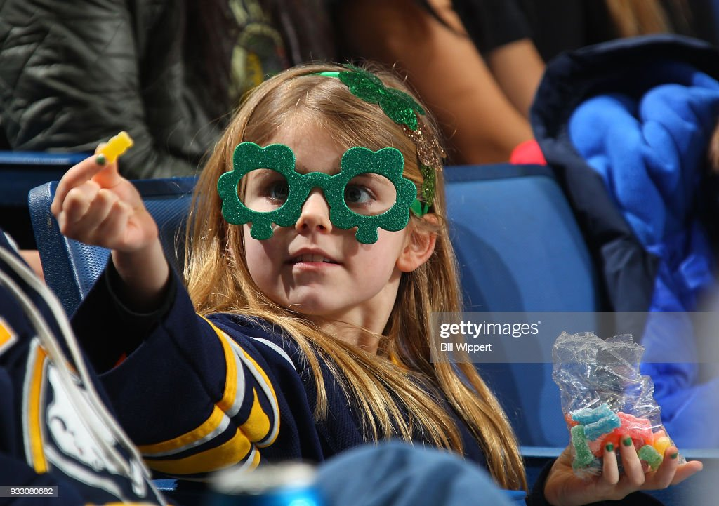 premium selection 9f62f 19155 A Buffalo Sabres fan wearing St. Patrick's Day glasses ...