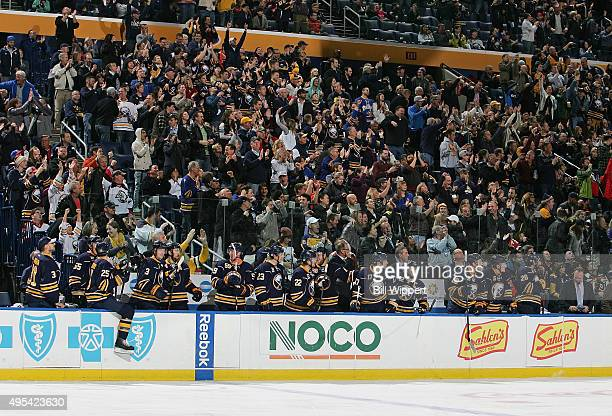 Buffalo Sabres fans cheer for a goal against the Philadelphia Flyers during an NHL game on October 30 2015 at the First Niagara Center in Buffalo New...