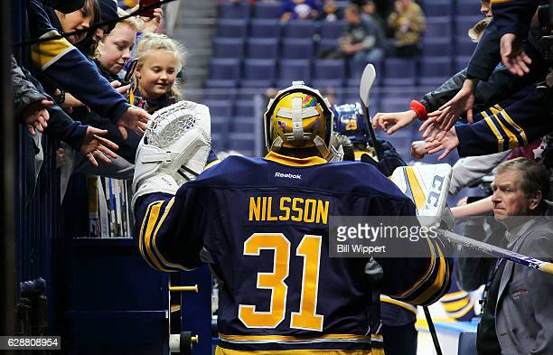 Buffalo Sabres goalie Anders Nilsson is greeted by fans as he heads to the ice for warmups prior to an NHL game against the Washington Capitals at...