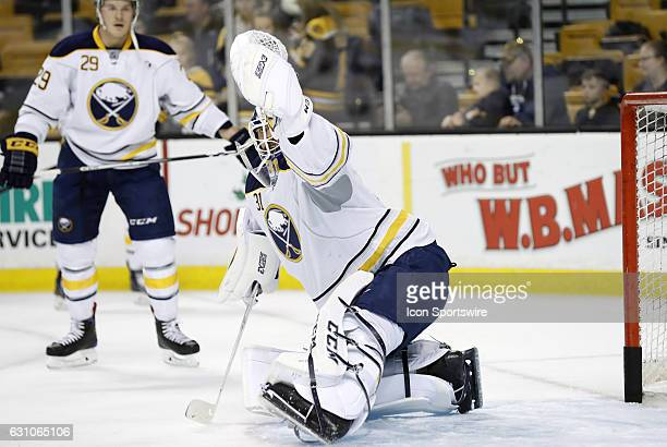 Buffalo Sabres goalie Anders Nilsson makes a glove save in warm up before a regular season NHL game between the Boston Bruins and the Buffalo Sabres...