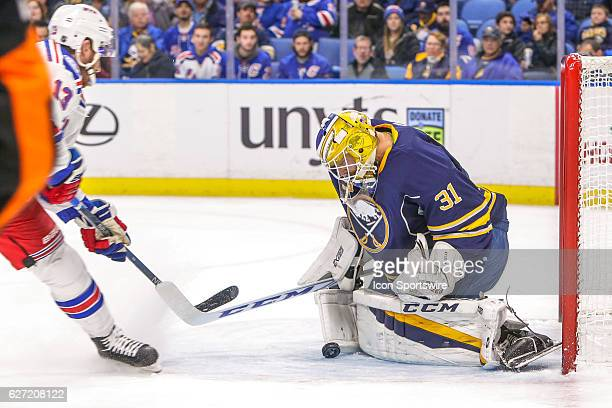 Buffalo Sabres Goalie Anders Nilsson makes save as New York Rangers Center Kevin Hayes looks for rebound during the New York Rangers and Buffalo...