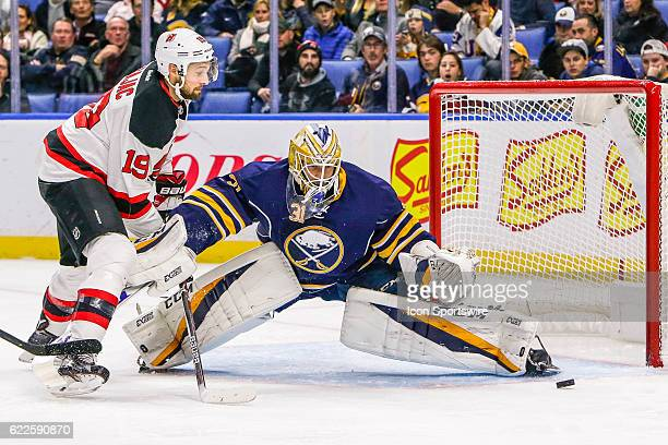 Buffalo Sabres Goalie Anders Nilsson prepares to make save while New Jersey Devils Center Travis Zajac looks for rebound during the New Jersey Devils...