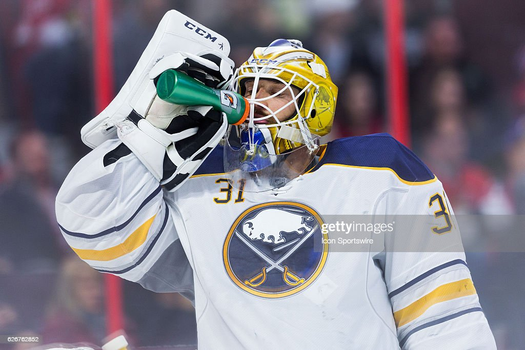 Buffalo Sabres Goalie Anders Nilsson (31) takes a drink of water during second period National Hockey League action between the Buffalo Sabres and Ottawa Senators on November 29, 2016, at Canadian Tire Centre in Ottawa, ON, Canada.