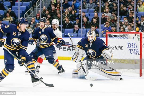 Buffalo Sabres Goalie Chad Johnson tracks puck as Buffalo Sabres Defenseman Jake McCabe and Buffalo Sabres Defenseman Josh Gorges defend the Sabres...