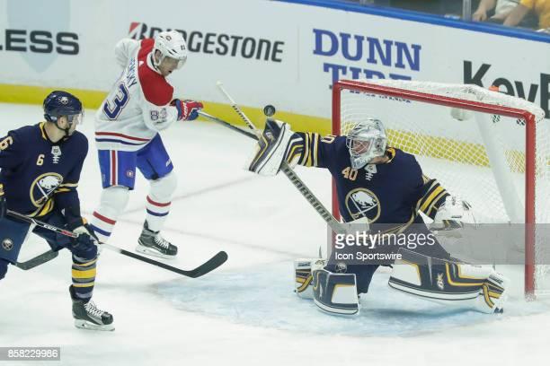 Buffalo Sabres Goalie Robin Lehner makes save on shot by Montreal Canadiens Right Wing Ales Hemsky as Buffalo Sabres Defenseman Marco Scandella looks...