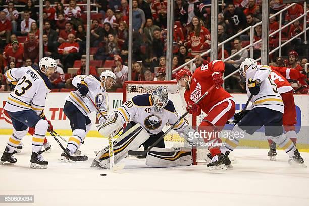 Buffalo Sabres goalie Robin Lehner of Sweden blocks a shot while Detroit Red Wings forward Thomas Vanek of Austria tries to control the puck on a...