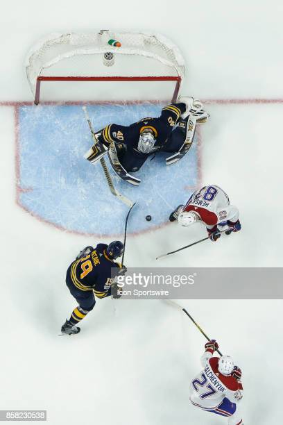 Buffalo Sabres Goalie Robin Lehner prepares to make save as Montreal Canadiens Right Wing Ales Hemsky looks for rebound and Buffalo Sabres Defenseman...