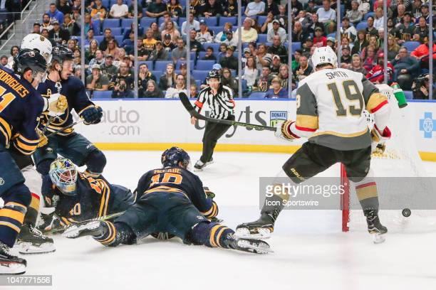Buffalo Sabres goaltender Carter Hutton and Buffalo Sabres defenseman Jake McCabe track loose puck as Vegas Golden Knights right wing Reilly Smith...