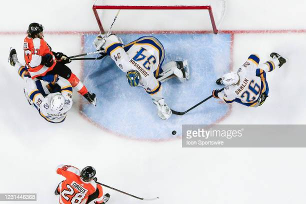 Buffalo Sabres goaltender Jonas Johansson reaches to cover puck after save on shot by Philadelphia Flyers center Kevin Hayes as Buffalo Sabres...