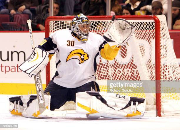Buffalo Sabres' goaltender Ryan Miller makes a glove save against the New Jersey Devils during the second period of NHL action at the Continental...