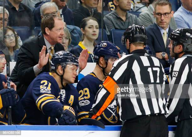 Buffalo Sabres head coach Phil Housley argues a call with referee Frederick L'Ecuyer during the second period against the Vancouver Canucks at the...
