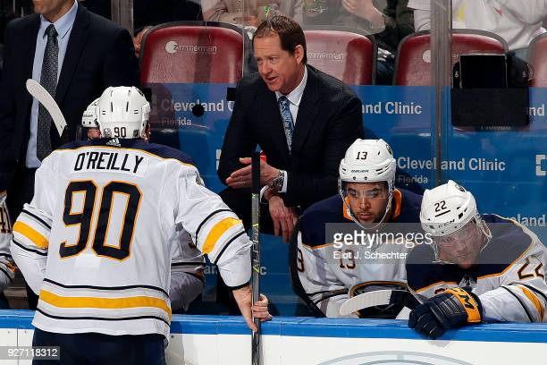 Buffalo Sabres Head Coach Phil Housley chats with Ryan O'Reilly during a break in the action against the Florida Panthers at the BBT Center on March...