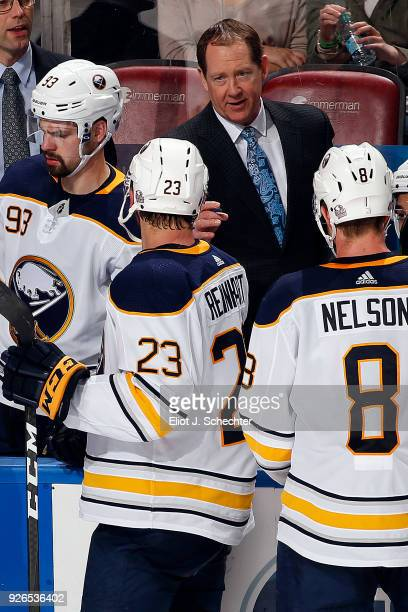 Buffalo Sabres Head Coach Phil Housley directs his team from the bench against the Florida Panthers at the BBT Center on March 2 2018 in Sunrise...
