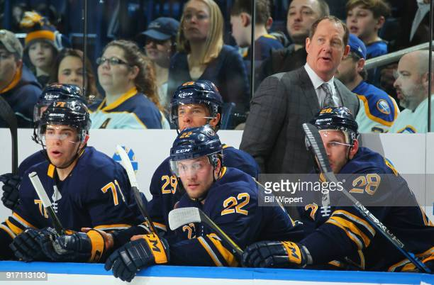 Buffalo Sabres head coach Phil Housley watches play against the Colorado Avalanche behind Evan Rodrigues Jason Pominville Johan Larsson and Zemgus...