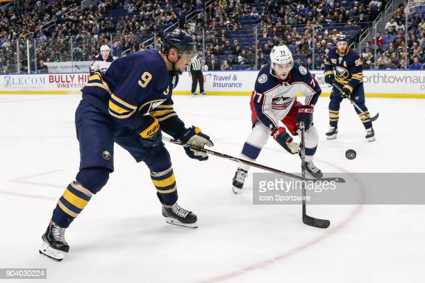 Buffalo Sabres Left Wing Evander Kane and Columbus Blue Jackets Right Wing Josh Anderson fight for puck during the Columbus Blue Jackets and Buffalo...