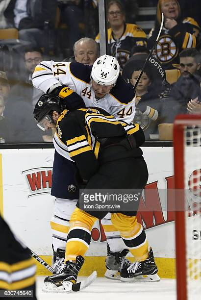 Buffalo Sabres left wing Nicolas Deslauriers punches Boston Bruins right defenseman Colin Miller during a regular season NHL game between the Boston...