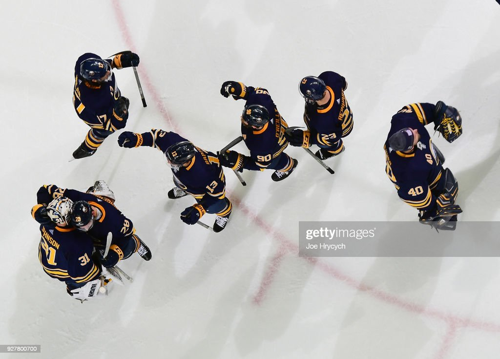 Buffalo Sabres players celebrate after defeating the Toronto Maple Leafs in an NHL game on March 5, 2018 at KeyBank Center in Buffalo, New York. Buffalo won, 5-3.