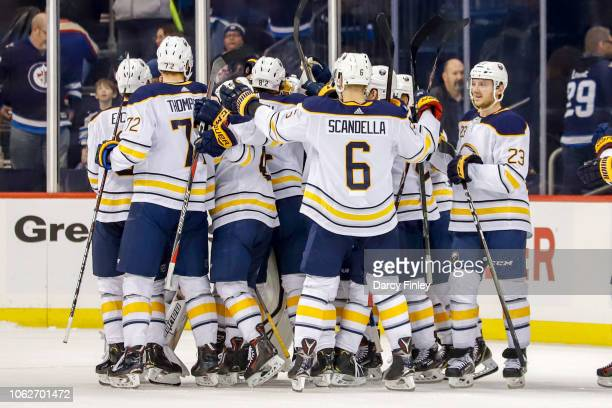 Buffalo Sabres players celebrate following a 21 shootout victory over the Winnipeg Jets at the Bell MTS Place on November 16 2018 in Winnipeg...
