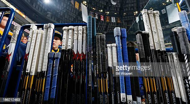 Buffalo Sabres players hockey sticks sit in the rack before their game against the Colorado Avalanche on October 19 2013 at the First Niagara Center...