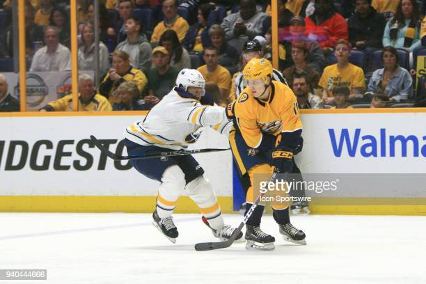 Buffalo Sabres right wing Kyle Okposo defends against Nashville Predators right wing Eeli Tolvanen during the NHL game between the Nashville...