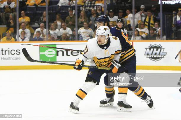 Buffalo Sabres right wing Michael Frolik and Nashville Predators right wing Viktor Arvidsson of Sweden battle for position during the NHL game...