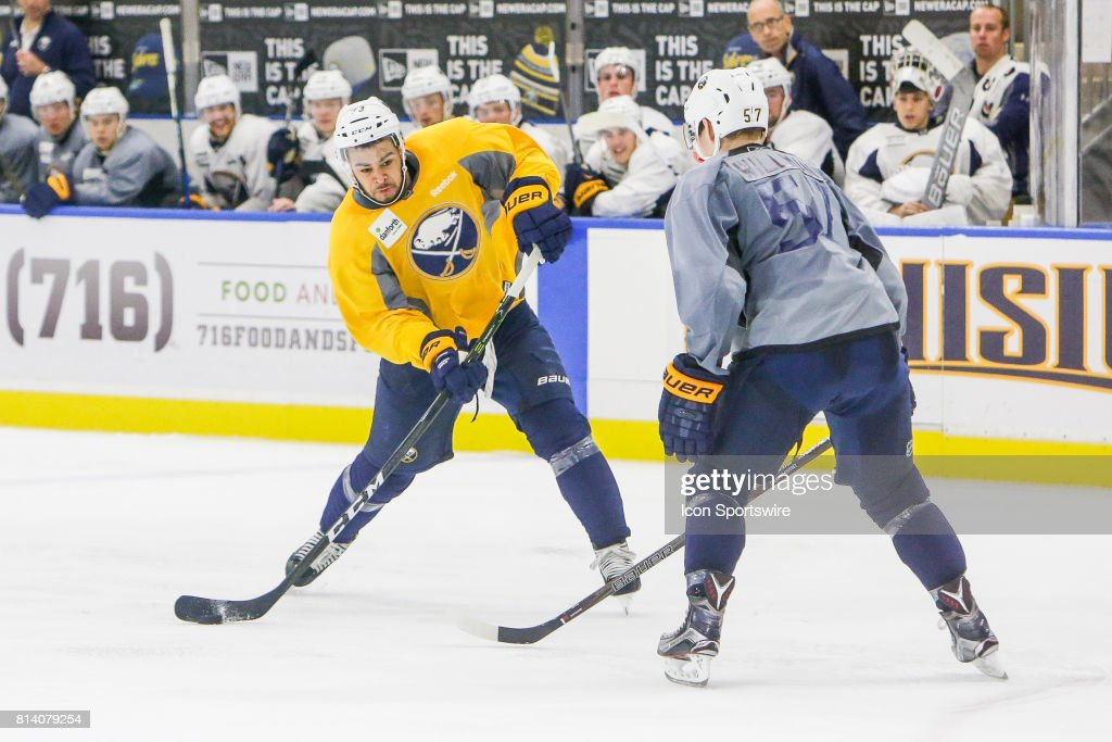 Buffalo Sabres Right Wing Nicholas Baptiste (73) takes shot as Buffalo Sabres Center William Maxwell (57) defends during the French Connection Tournament at the Buffalo Sabres Development Camp on July 11, 2017, at HarborCenter in Buffalo, NY.