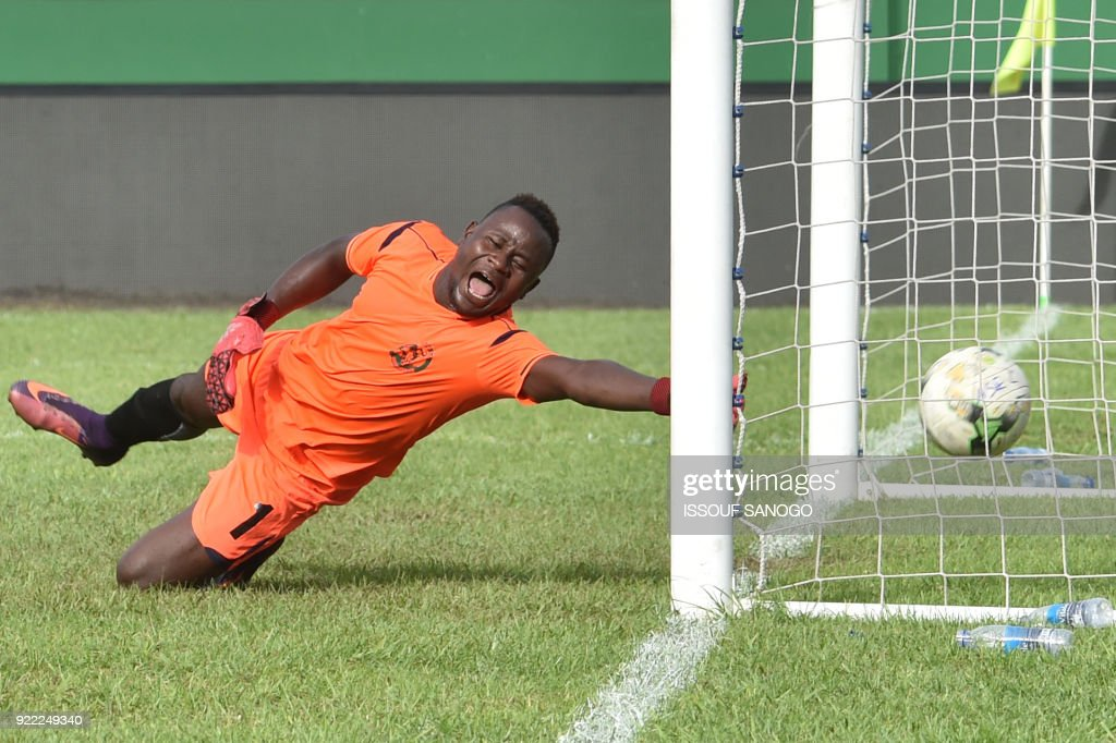Buffaloe's goalkeeper Soffo Souradjou concedes a goal during the African Champions league football match between Asec d'Abidjan and Buffaloes of Benin at the Felix Houphouet-Boigny stadium in Abidjan on February 21, 2018. /