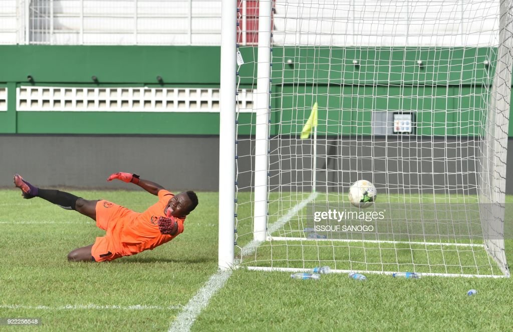 Buffaloes of Benin goalkeeper Soffo Souradjou concedes a goal during the African Champions league football match between Asec d'Abidjan and Buffaloes of Benin at the Felix Houphouet-Boigny stadium in Abidjan on February 21, 2018. /