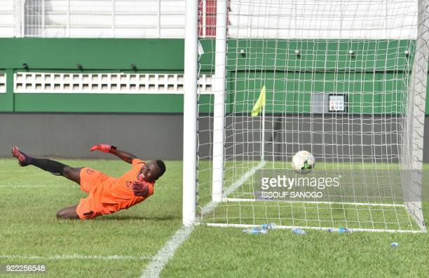 Buffaloes of Benin goalkeeper Soffo Souradjou concedes a goal during the African Champions league football match between Asec d'Abidjan and Buffaloes...