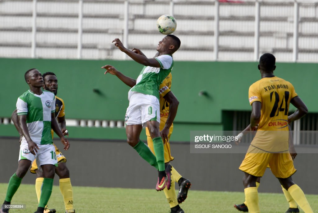Buffaloes of Benin player Rodrigue Akossi (C) heads the ball during the African Champions league football match between Asec d'Abidjan and Buffaloes of Benin at the Felix Houphouet-Boigny stadium in Abidjan on February 21, 2018. /
