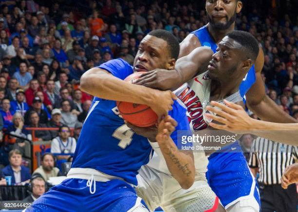 Buffalo's Davonta Jordan wrestles with Arizona's Rawie Alkins in the first round of the NCAA Tournament's West Regional on Thursday March 15 at Taco...