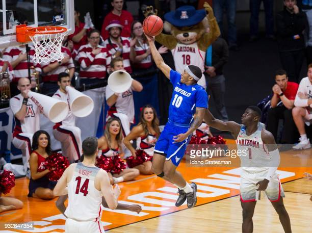 Buffalo's Wes Clark drives past Arizona's Rawie Alkins to score in the first round of the NCAA Tournament's West Regional on Thursday March 15 at...