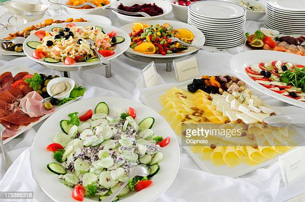 buffet of cheeses and salads - ogphoto stock photos and pictures