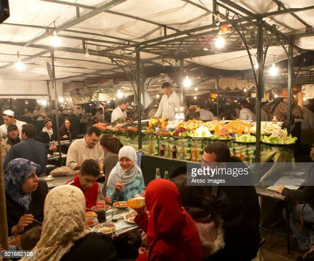 buffet table and diners - femme marocaine photos et images de collection
