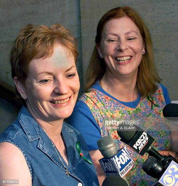 Buffy Hall and Meg Wakeman the sisters of Holly Maddux talk to the press as they arrive at the 30th Street Station in Philadelphia PA 20 July 2001...