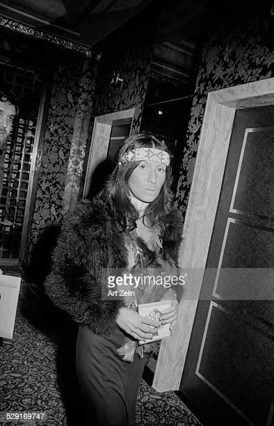 Buffy SainteMarie wearing beaded headband and fur jacket circa 1970 New York