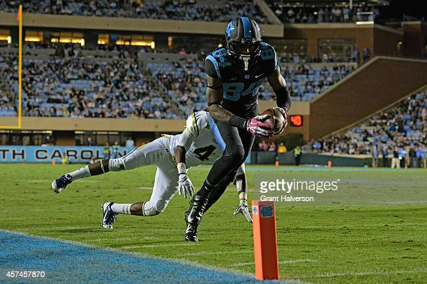 Bug Howard of the North Carolina Tar Heels beats Jamal Golden of the Georgia Tech Yellow Jackets to the pylon for a touchdown during the first half...