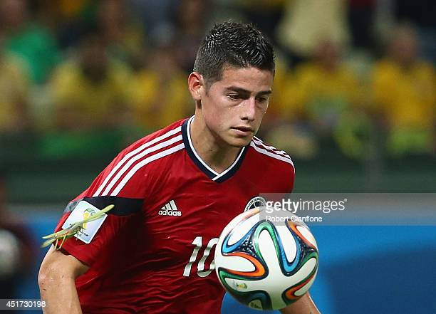A bug lands on the arm of James Rodriguez of Colombia as he celebrates scoring his team's first goal on a penalty kick during the 2014 FIFA World Cup...