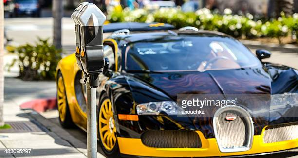 bugatti parked on rodeo drive, beverly hills, usa - bugatti stock photos and pictures