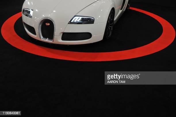A Bugatti Veyron 164 Grand Sport the fastest convertible car in the world is seen at the Top Marques Macau car show in Macau on November 25 2011 The...