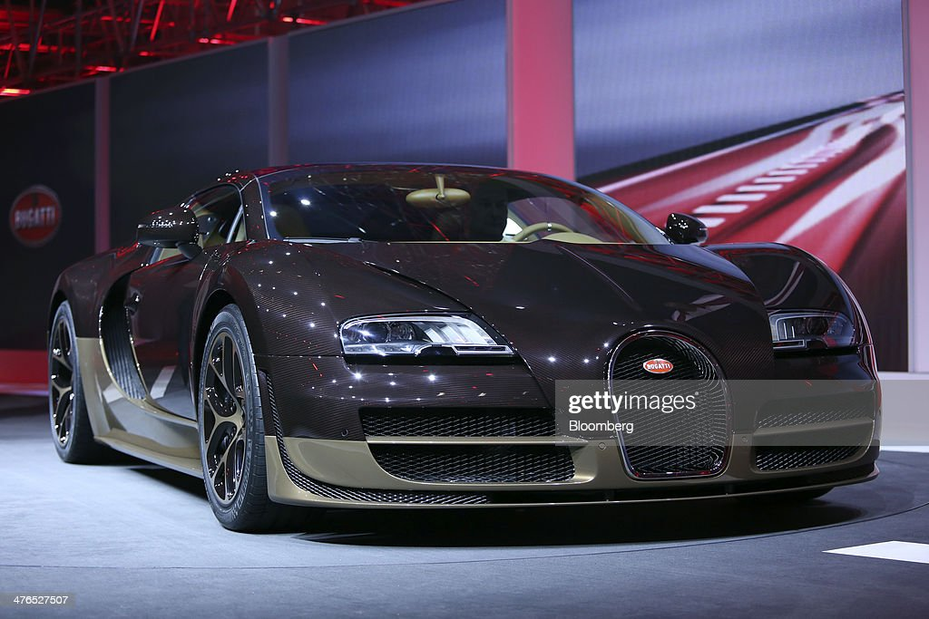 A Bugatti Veyron Rembrandt automobile, produced by Volkswagen AG, stands on display during a news conference ahead of the opening day of the 84th Geneva International Motor Show in Geneva, Switzerland, on Monday, March 3, 2014. The International Geneva Motor Show will run from Mar. 4, and showcase the latest models from the world's top automakers. Photographer: Chris Ratcliffe/Bloomberg via Getty Images