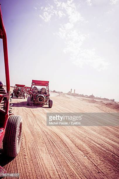 Buggies Driving In Desert