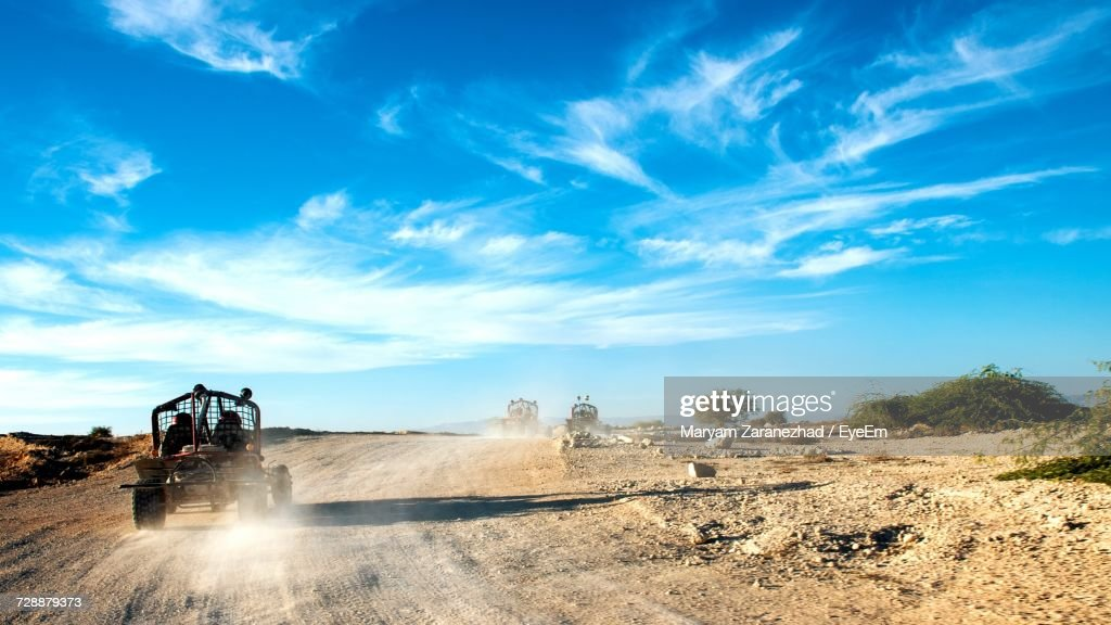 Buggy On Dirt Road During Sunny Day : Stock Photo